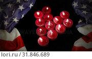 Burning Candles and american flag. Стоковое видео, агентство Wavebreak Media / Фотобанк Лори