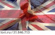 UK flag with judge gavel on documents. Стоковое видео, агентство Wavebreak Media / Фотобанк Лори