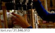 Купить «Close-up of woman filling grains in to jar from vending machine 4k», видеоролик № 31846913, снято 13 сентября 2018 г. (c) Wavebreak Media / Фотобанк Лори