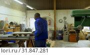 Купить «Worker working at table in workshop 4k», видеоролик № 31847281, снято 27 сентября 2018 г. (c) Wavebreak Media / Фотобанк Лори