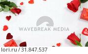 Купить «Red roses, gift boxes and heart shape of confetti on white surface in circle formation 4k», видеоролик № 31847537, снято 11 октября 2018 г. (c) Wavebreak Media / Фотобанк Лори