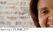 Купить «Close-up of mature woman looking at camera at home 4k», видеоролик № 31848277, снято 7 ноября 2018 г. (c) Wavebreak Media / Фотобанк Лори