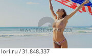 Купить «Front view of young Caucasian woman holding a American flag on the beach 4k», видеоролик № 31848337, снято 6 ноября 2018 г. (c) Wavebreak Media / Фотобанк Лори