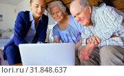 Купить «Senior couple with real estate agent discussing over laptop at home 4k», видеоролик № 31848637, снято 6 ноября 2018 г. (c) Wavebreak Media / Фотобанк Лори