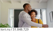 Купить «Front view of happy black couple standing in their new house 4k», видеоролик № 31848729, снято 7 ноября 2018 г. (c) Wavebreak Media / Фотобанк Лори