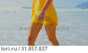 Купить «Woman walking on the beach 4k», видеоролик № 31857837, снято 6 ноября 2018 г. (c) Wavebreak Media / Фотобанк Лори