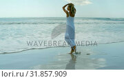 Купить «Rear view of young Caucasian woman enjoying her holidays on the beach 4k», видеоролик № 31857909, снято 6 ноября 2018 г. (c) Wavebreak Media / Фотобанк Лори