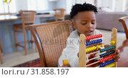 Купить «Front view of black boy playing with abacus at comfortable home 4k», видеоролик № 31858197, снято 7 ноября 2018 г. (c) Wavebreak Media / Фотобанк Лори