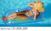 Купить «High angle view of young mixed-race woman relaxing on floating pool lounger in swimming pool 4k», видеоролик № 31858289, снято 7 ноября 2018 г. (c) Wavebreak Media / Фотобанк Лори