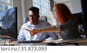 Купить «Front view of young mixed-race business team planning and working on desktop pc in modern office 4k», видеоролик № 31873093, снято 6 октября 2018 г. (c) Wavebreak Media / Фотобанк Лори
