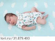 Купить «Full length of sleeping Caucasian baby one month old, lying on light blue bedsheet with white clouds», фото № 31879493, снято 18 июня 2019 г. (c) Кекяляйнен Андрей / Фотобанк Лори