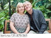 Купить «Happy and smiling retired husband and wife portrait, sitting on bench cheek to cheek together», фото № 31879561, снято 15 июня 2019 г. (c) Кекяляйнен Андрей / Фотобанк Лори