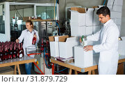 Купить «Man standing in packing section on winemaking factory», фото № 31879729, снято 21 сентября 2016 г. (c) Яков Филимонов / Фотобанк Лори