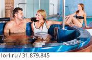 Купить «Woman with man are talking in pool», фото № 31879845, снято 18 июля 2017 г. (c) Яков Филимонов / Фотобанк Лори