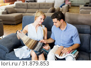Купить «Couple are choosing of colors for new sofa», фото № 31879853, снято 19 июня 2017 г. (c) Яков Филимонов / Фотобанк Лори