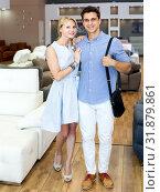 Купить «Man and woman are happyning of new sofa», фото № 31879861, снято 19 июня 2017 г. (c) Яков Филимонов / Фотобанк Лори