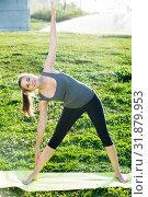 Купить «sporty female doing aerobics on mat in green park», фото № 31879953, снято 8 июня 2017 г. (c) Яков Филимонов / Фотобанк Лори