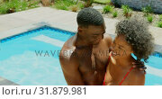 Купить «High angle view of young black couple embracing each other near swimming pool 4k», видеоролик № 31879981, снято 7 ноября 2018 г. (c) Wavebreak Media / Фотобанк Лори