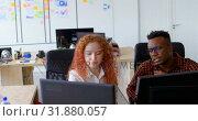 Купить «Front view of young cool mixed-race business team planning and sitting at desk in a modern office 4k», видеоролик № 31880057, снято 6 октября 2018 г. (c) Wavebreak Media / Фотобанк Лори