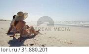 Купить «Couple relaxing together at beach 4k», видеоролик № 31880201, снято 14 ноября 2018 г. (c) Wavebreak Media / Фотобанк Лори