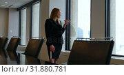 Купить «Businesswoman talking on mobile phone in office 4k», видеоролик № 31880781, снято 24 ноября 2018 г. (c) Wavebreak Media / Фотобанк Лори