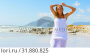 Купить «Front view of young caucasian woman standing at beach 4k», видеоролик № 31880825, снято 6 ноября 2018 г. (c) Wavebreak Media / Фотобанк Лори