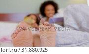 Купить «Close-up of black mother and daughter reading story book in a comfortable home 4k», видеоролик № 31880925, снято 7 ноября 2018 г. (c) Wavebreak Media / Фотобанк Лори