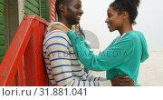 Купить «Side view of young romantic black couple embracing and standing at beach hut on a sunny day 4k», видеоролик № 31881041, снято 14 ноября 2018 г. (c) Wavebreak Media / Фотобанк Лори