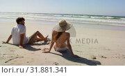 Купить «Couple relaxing together at beach 4k», видеоролик № 31881341, снято 14 ноября 2018 г. (c) Wavebreak Media / Фотобанк Лори