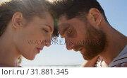 Купить «Romantic couple embracing each other at beach 4k», видеоролик № 31881345, снято 14 ноября 2018 г. (c) Wavebreak Media / Фотобанк Лори