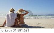 Купить «Couple relaxing together at beach 4k», видеоролик № 31881621, снято 14 ноября 2018 г. (c) Wavebreak Media / Фотобанк Лори