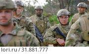 Купить «Front view of mixed-race military soldiers rifle training in fields during military training 4k », видеоролик № 31881777, снято 27 июня 2018 г. (c) Wavebreak Media / Фотобанк Лори