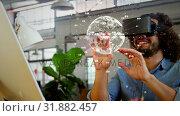Купить «Man in the office using virtual reality», видеоролик № 31882457, снято 20 декабря 2018 г. (c) Wavebreak Media / Фотобанк Лори