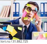 Купить «Businessman with reminder notes in multitasking concept», фото № 31882725, снято 26 сентября 2017 г. (c) Elnur / Фотобанк Лори