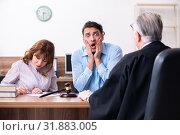 Купить «Young couple in the courthouse in divorce concept», фото № 31883005, снято 28 марта 2019 г. (c) Elnur / Фотобанк Лори