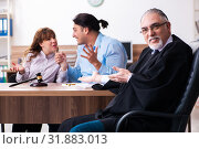 Young couple in the courthouse in divorce concept. Стоковое фото, фотограф Elnur / Фотобанк Лори