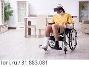 Купить «Young man after accident recovering at home», фото № 31883081, снято 3 мая 2019 г. (c) Elnur / Фотобанк Лори