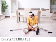 Купить «Young man after accident recovering at home», фото № 31883153, снято 3 мая 2019 г. (c) Elnur / Фотобанк Лори