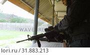 Купить «Side view of young black military soldier loading rifle during military training 4k», видеоролик № 31883213, снято 27 июня 2018 г. (c) Wavebreak Media / Фотобанк Лори