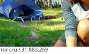Купить «Man preparing bonfire in the forest on a sunny day 4k», видеоролик № 31883269, снято 12 октября 2018 г. (c) Wavebreak Media / Фотобанк Лори