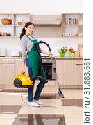 Купить «Young female contractor doing housework», фото № 31883681, снято 22 февраля 2019 г. (c) Elnur / Фотобанк Лори