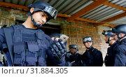 Купить «Front view of young caucasian military soldier looking at mobile phone in military base 4k», видеоролик № 31884305, снято 27 июня 2018 г. (c) Wavebreak Media / Фотобанк Лори