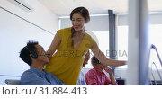Купить «Pretty Caucasian female executive discussing over personal computer in modern office 4k», видеоролик № 31884413, снято 18 ноября 2018 г. (c) Wavebreak Media / Фотобанк Лори