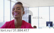 Купить «Pretty mixed-race female executive standing in modern office 4k», видеоролик № 31884417, снято 18 ноября 2018 г. (c) Wavebreak Media / Фотобанк Лори