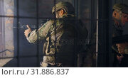 Купить «Side view of caucasian military soldiers firing through window during military training 4k», видеоролик № 31886837, снято 27 июня 2018 г. (c) Wavebreak Media / Фотобанк Лори