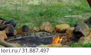 Купить «Close-up of campfire at campsite 4k», видеоролик № 31887497, снято 12 октября 2018 г. (c) Wavebreak Media / Фотобанк Лори