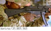 Купить «Side view of black military soldiers shooting rifle in target practice during training 4k», видеоролик № 31901161, снято 27 июня 2018 г. (c) Wavebreak Media / Фотобанк Лори