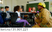 Купить «Young handsome Caucasian male firefighter teaching schoolgirl about fire safety in classroom 4k», видеоролик № 31901221, снято 10 ноября 2018 г. (c) Wavebreak Media / Фотобанк Лори
