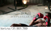 Купить «African American male boxer practicing boxing with trainer in fitness studio 4k», видеоролик № 31901789, снято 17 октября 2018 г. (c) Wavebreak Media / Фотобанк Лори