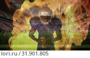 Купить «Angry american football of player with fire behind him », видеоролик № 31901805, снято 16 января 2019 г. (c) Wavebreak Media / Фотобанк Лори